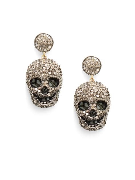 lyst bavna pave diamond skull drop earrings  metallic