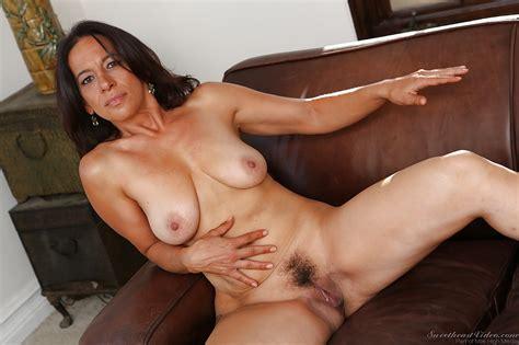 mature brunette melissa monet stripping and spreading her legs
