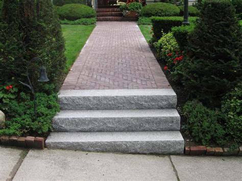 Unilock Steps - salt pepper granite steps with a unilock copthorne