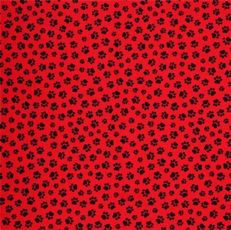 tela roja animales huellas de perro negras telas
