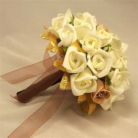 ivory rosebud gold leaf bouquet wedding flowers