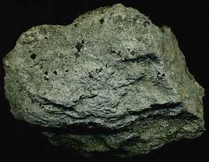 The garnet-muscovite schist shown above is early ...