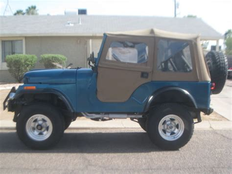 black and teal jeep seller of classic cars 1971 jeep cj teal green tan and
