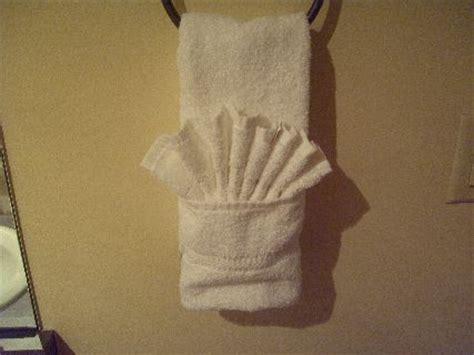 towel folding ideas for bathrooms iphone bike mount towel folding and fishing line cable management lifehacker australia