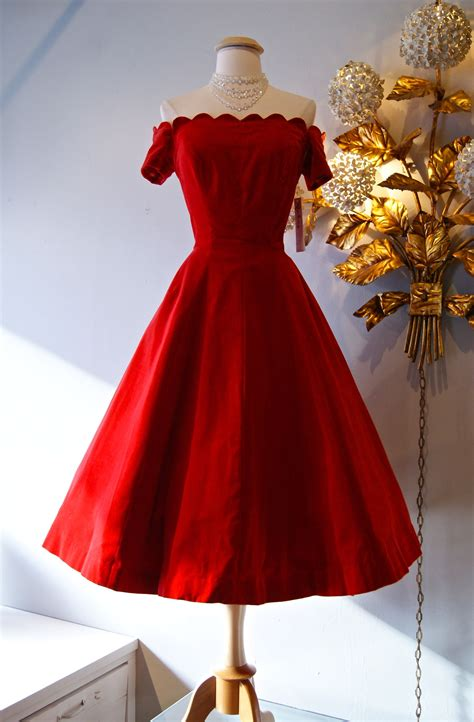 a smashing 1950s red velvet party dress with a scalloped