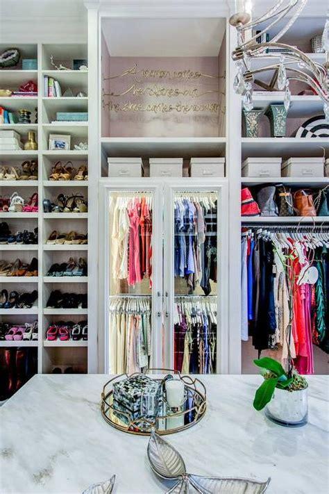 glass front wardrobe cabinets  custom lighting transitional closet