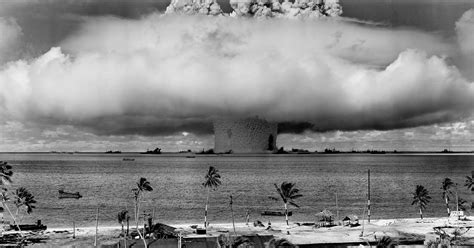 Grayscale Photo Of Explosion On The Beach · Free Stock Photo