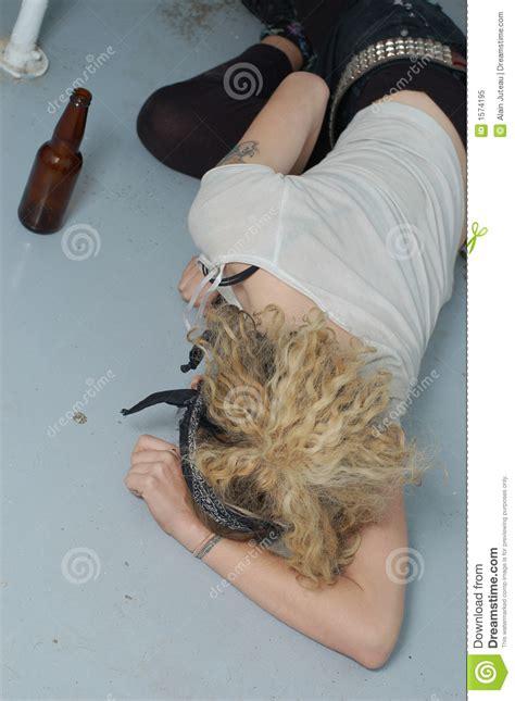 drunk girl   floor focus  head left hand stock