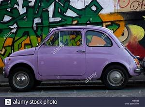 Fiat 500 Violet : italian old small car fiat 500 with graffiti on the background urban stock photo royalty free ~ Gottalentnigeria.com Avis de Voitures