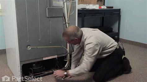 refrigerator repair replacing  condenser fan motor kit