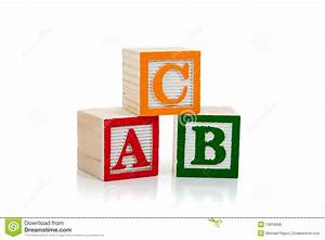 colored wooden letter blocks on a white background royalty With colored letter blocks