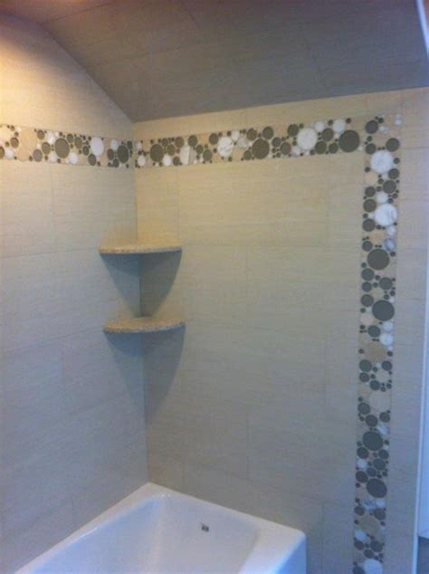 Accent Flooring by Shower Using Porcelain Tile And Bubble Glass Accents