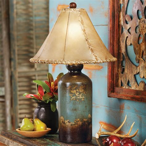 turquoise pottery table lamp  rawhide shade