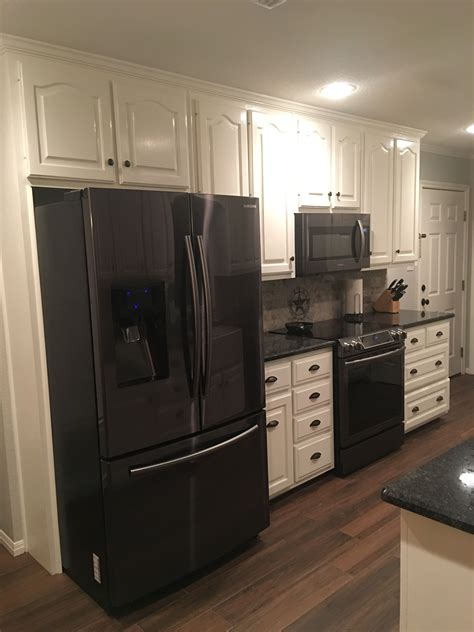 kitchen with hardwood floor pictures black stainless steel appliances steel gray counter tops 8751