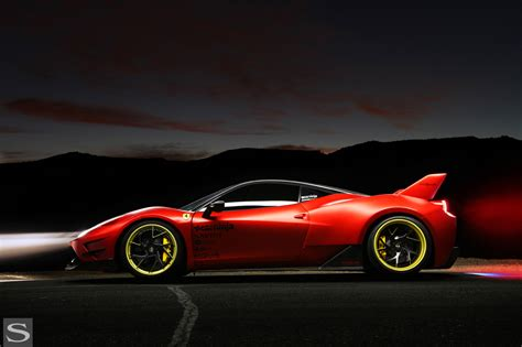 Those wheels sparkle in the sun for sure, the exhaust tips and ferrari badges are also gold, the car is actually wrapped in matt black, underneath is the classic ferrari red. 458 Italia - Savini Wheels