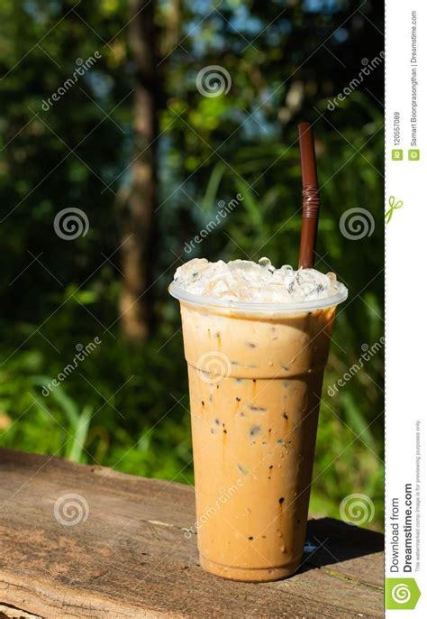 I lvled to 100 only doing pure xoph's Iced Coffee And A Background Of Green Trees. Stock Image - Image of design, drink: 120557089