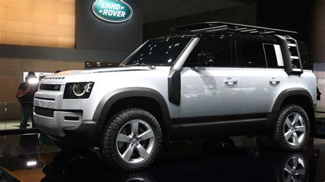 land rover defender debuts   tech  charm