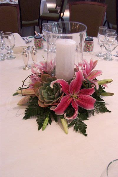 Hurricane Vase Centerpieces For Weddings by Centerpiece Hurricane L With Lilies And Succulents