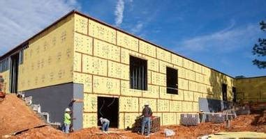Sheathing with WRB-AB accelerates exterior wall installation.