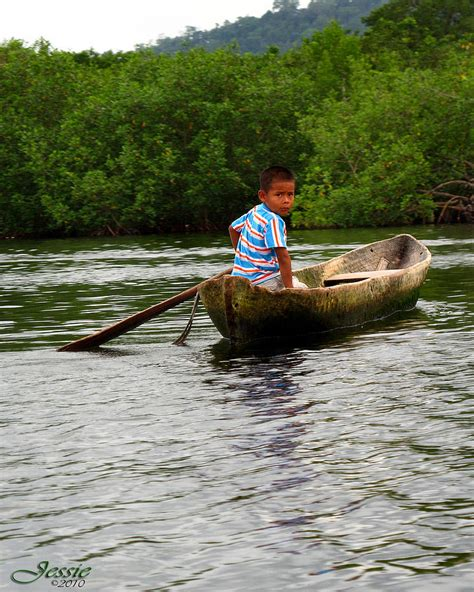Canoes This In Panama boy in dugout canoe panama photograph by westermeyer