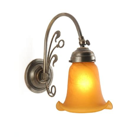 replica victorian wall light in aged brass with amber
