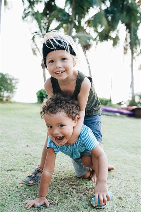 Sort by album sort by song. Two Happy Little Boys Hug Each Other Stock Photo - Image ...