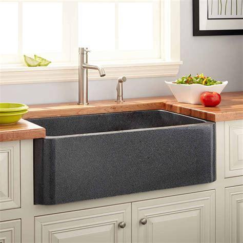 polished granite farmhouse sink blue gray kitchen