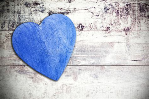 wooden blue heart  timbered background space  text