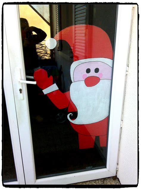 pere noel de bienvenu  accrocher  la porte dentree