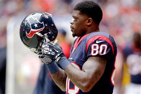Andre Johnson reports to Houston Texans' training camp