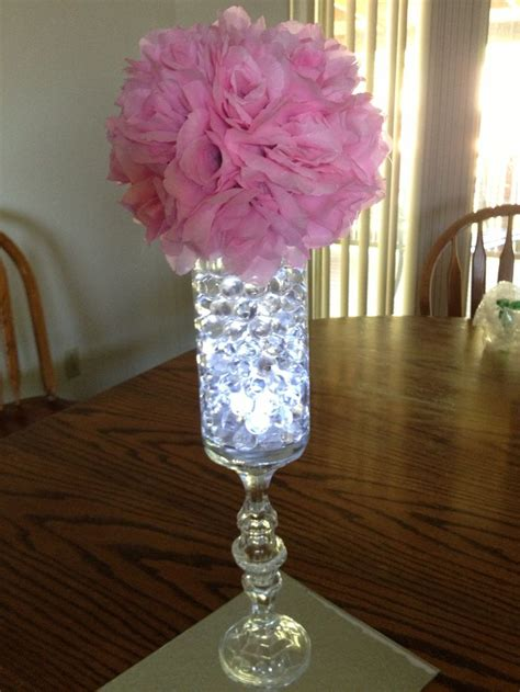 water beads and submersible led light and rose pomander on