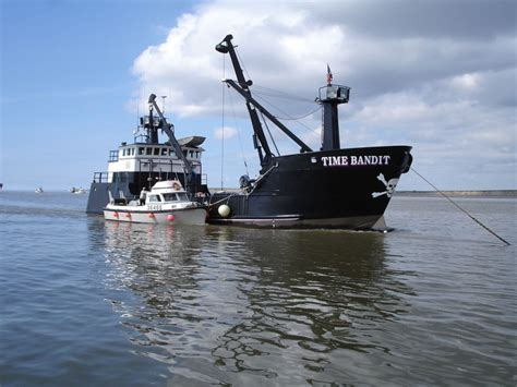 Seabrooke Fishing Boat Captain by Offloading Salmon To The Time Bandit Of Deadliest Catch