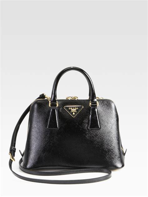 718b7499bd41 2000 x 2667 www.lyst.com. Prada Saffiano Vernice Small Round Tophandle Bag  ...