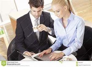 Two Business People With Laptop Stock Image - Image: 33834567
