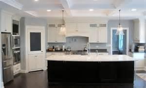 white shaker kitchen  glass top area dark island
