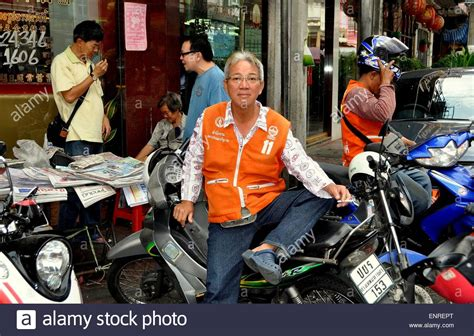 Motorcycle Taxi Driver Sitting On His Bike Stock Photo, Royalty Free Image