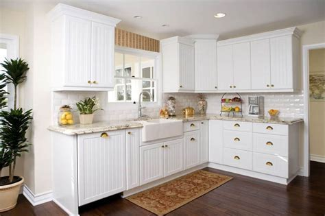 L Shaped Kitchen Using White Beadboard Cabinet Doors And