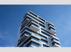 White Concrete Building Under Sunny Blue Sky · Free Stock