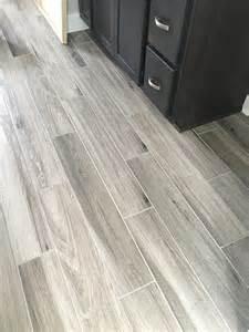 Gray Plank Tile Flooring in Bathrooms