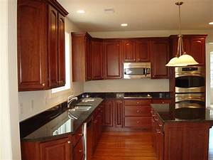 black granite countertops with oak cabinets With best brand of paint for kitchen cabinets with rock music wall art