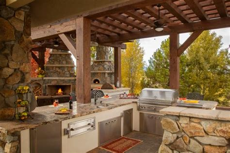 rustic outdoor kitchen  stainless steel appliances hgtv