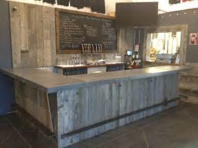 repurposed kitchen island crafted reclaimed wood tasting room wall cladding