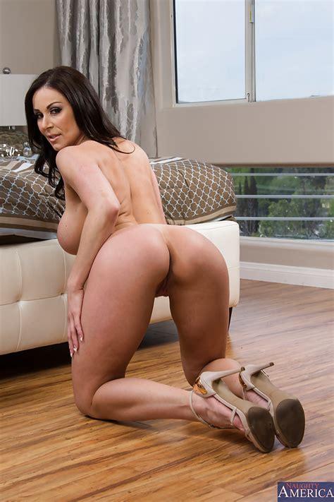 Big Ass Brunette Bending Over And Spreading Her Shaved