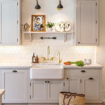 Light Gray Kitchen Cabinets with White Square Backsplash