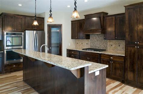 Venetian gold granite, hickory softscraped floors, alder