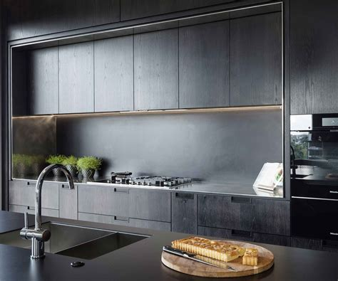 Kitchen Bench Repairs Auckland by A Striking Black Kitchen Makes A Stylish Statement In This