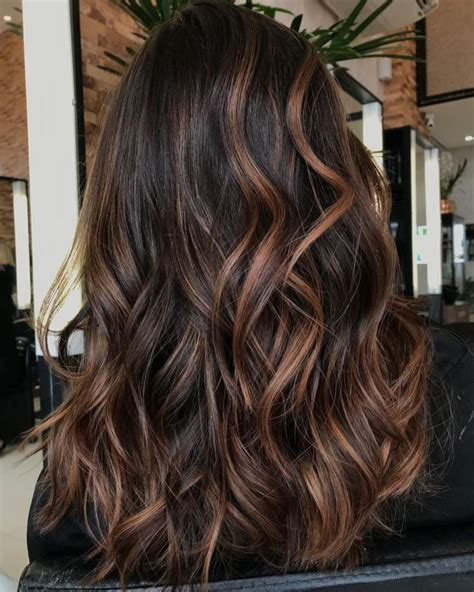 hairstyles featuring dark brown hair  highlights