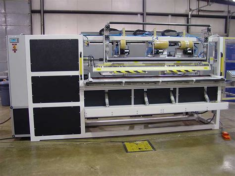 Carpet Rolling Machine by Rug And Mat Packaging Machines Automated Designs