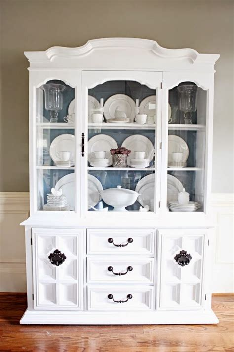 where to put dishes in kitchen cabinets tips on how to arrange a china cabinet average but inspired 2191