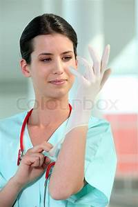 Female Doctor Putting On Rubber Gloves